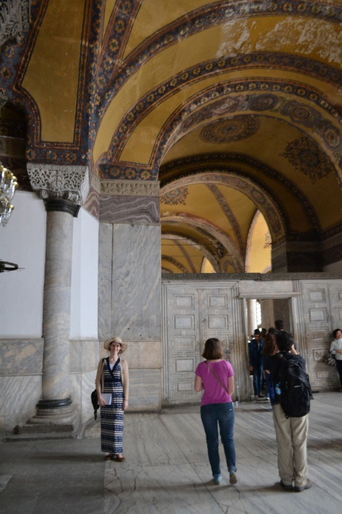 Gold mosaics adorn the ceilings, except the swathes where time and opportunistic visitors have nibbled them away.
